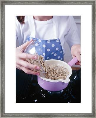 Making Porridge From Oats Framed Print by Veronique Leplat