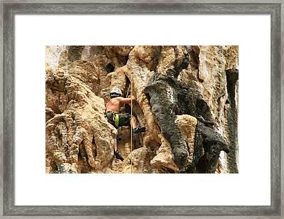 Man Climbing Rock Framed Print by Ulrike Maier