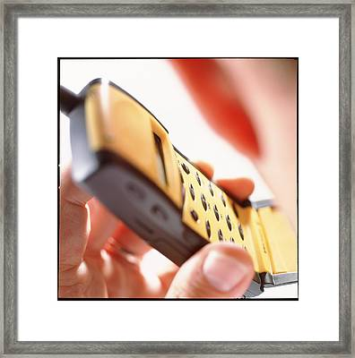 Man Holding A Mobile Telephone To His Ear Framed Print by Tek Image