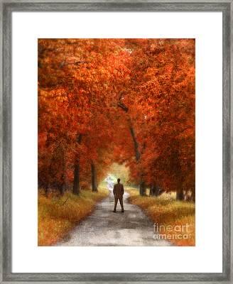Man In Suit On Rural Road In Autumn Framed Print by Jill Battaglia
