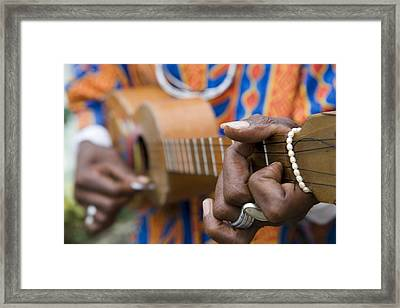 Man Playing Caribbean Mandolin, Grand Etang Forest Reserve Visitor Centre,  Grand Etang National Park, St George, Grenada, Central America & The Caribbean Framed Print by Holger Leue