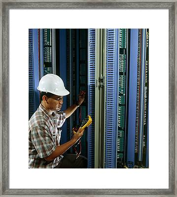 Man Testing Circuit Boards At Telephone Exchange Framed Print by Geoff Tompkinson