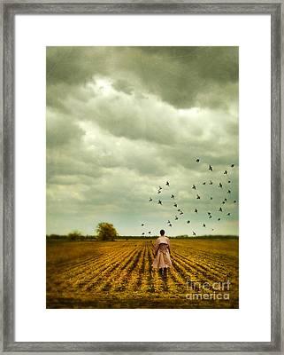 Man Walking In A Farm Field Framed Print by Jill Battaglia