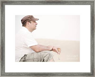 Man With Glass Of Champagner In The Dunes Framed Print by Iryna Shpulak