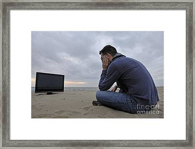 Man With Tv On Beach At Sunset Framed Print by Sami Sarkis