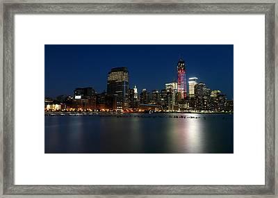 Manhattan Skyline At Night Framed Print by Larry Marshall