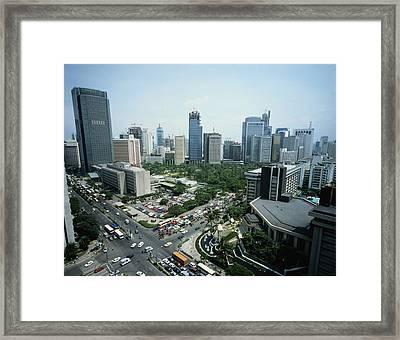 Manila Skyline Framed Print by John Wang