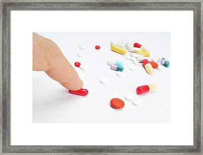 Man's Finger Touching Red Pill Framed Print by Sami Sarkis