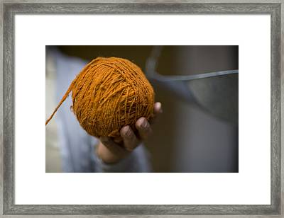 Mans Hand Holds Ball Of Orange Wool Framed Print by David Evans