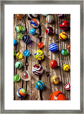 Marbles On Wooden Board Framed Print by Garry Gay