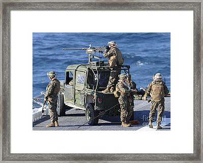Marines Provide Security Aboard Framed Print by Stocktrek Images