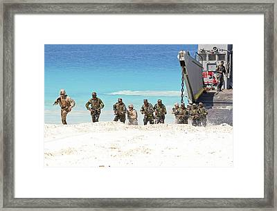 Marines Rush Ashore From A Ling Craft Framed Print by Stocktrek Images