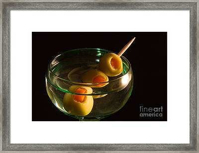 Martini Cocktail With Olives In A Green Glass Framed Print by ELITE IMAGE photography By Chad McDermott