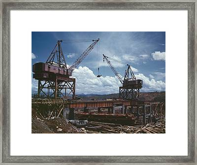 Massive Cranes On A Steel Framed Print by Everett