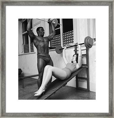 Matching Muscles Framed Print by John Drysdale