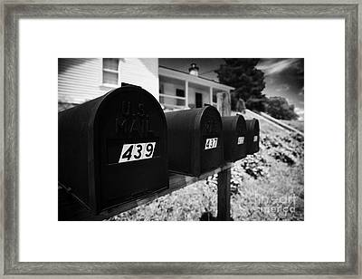 matt black american private mailboxes in front of houses Lynchburg tennessee usa Framed Print by Joe Fox