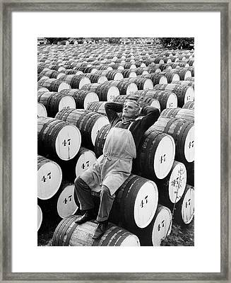 Mature Man Relaxing On Barrels (b&w) Framed Print by Hulton Archive