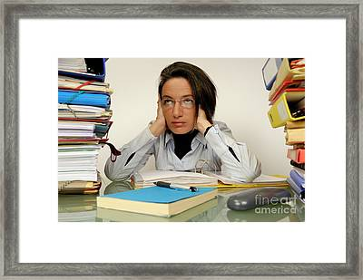 Mature Office Worker Sitting At Desk With Piles Of Folders Framed Print by Sami Sarkis