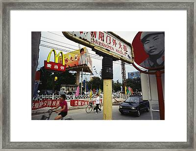 Mcdonalds And Other Signs Compete Framed Print by Justin Guariglia