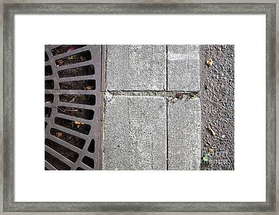 Metal Grate On Sidewalk Framed Print by Paul Edmondson