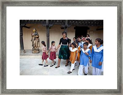 Michelle Obama Accompanied By Children Framed Print by Everett
