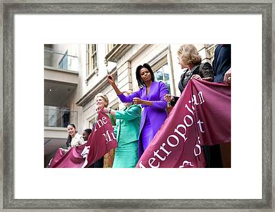 Michelle Obama Cuts The Ribbon Framed Print by Everett