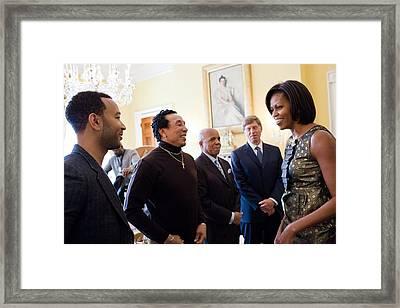 Michelle Obama Greets John Legend Framed Print by Everett