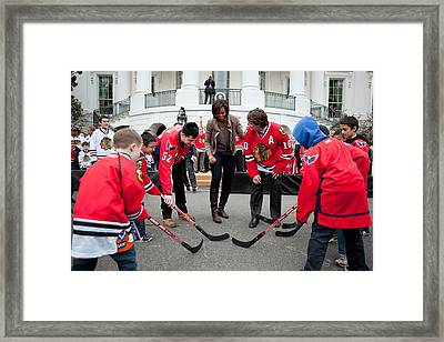 Michelle Obama Holds A Lets Move Framed Print by Everett