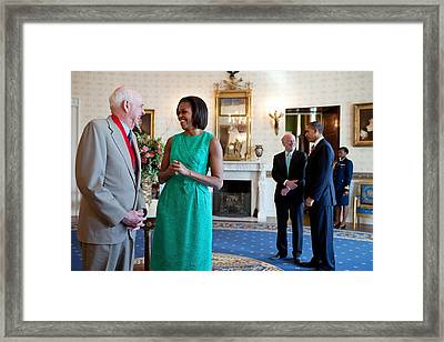 Michelle Obama Laughs With National Framed Print by Everett