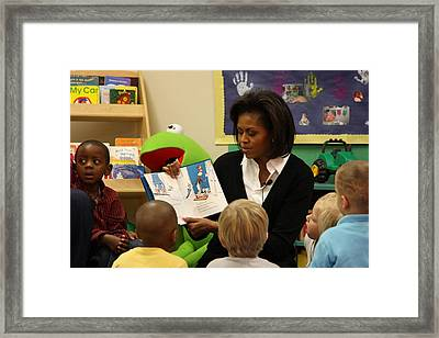 Michelle Obama Reads The Cat In The Hat Framed Print by Everett