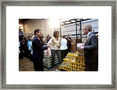 Michelle Obama Volunteers For Feeding Framed Print by Everett