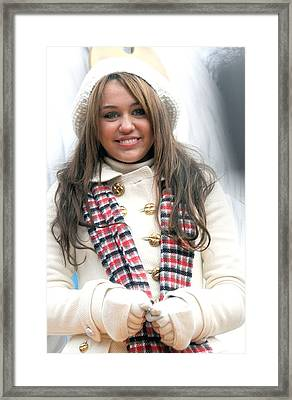 Miley Cyrus At A Public Appearance Framed Print by Everett