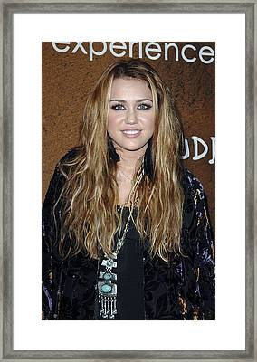 Miley Cyrus At Arrivals For Grand Framed Print by Everett