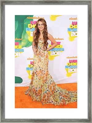 Miley Cyrus Wearing A Dolce & Gabbana Framed Print by Everett