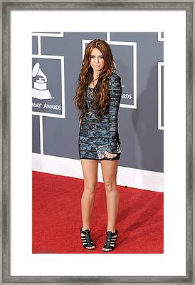 Miley Cyrus Wearing A Herve Leger Dress Framed Print by Everett