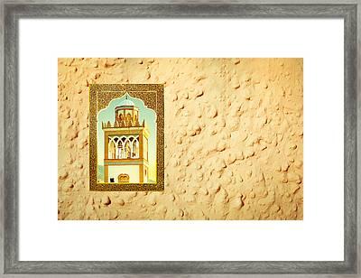 Minaret Through A Window Framed Print by Tom Gowanlock