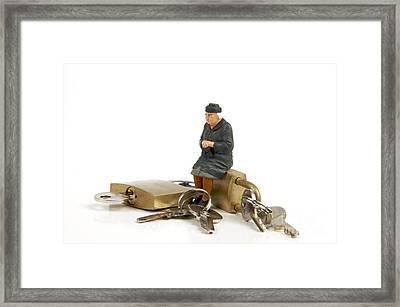 Miniature Figurines Of Elderly Sitting On Padlocks Framed Print by Bernard Jaubert