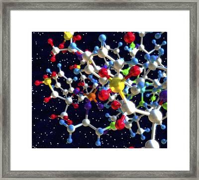 Molecule In Space Framed Print by Roger Harris