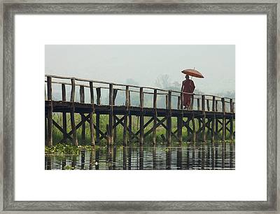 Monk Crosses A Bridge On The Eastern Shore Town Framed Print by David Greedy