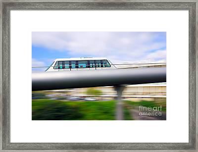 Monorail Carriage Framed Print by Carlos Caetano