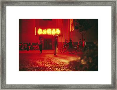 Motorcyclists Outside A Karaoke Bar Framed Print by Justin Guariglia