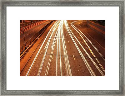 Motorway Light Trails Framed Print by Richard Newstead