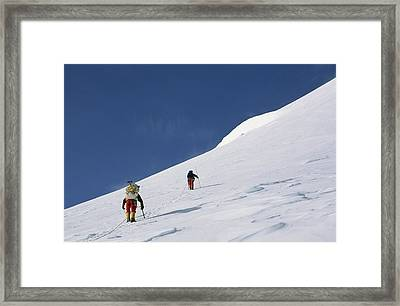 Mountain Climbers Use Safety Ropes Framed Print by Gordon Wiltsie