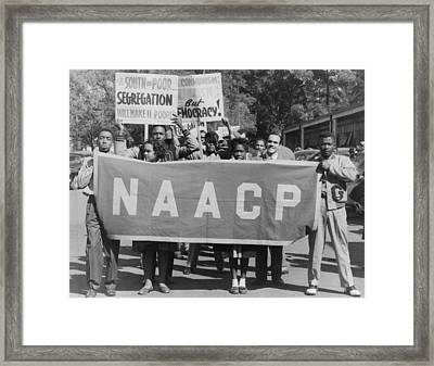 Naacp Banner Is Held By Protesters Framed Print by Everett
