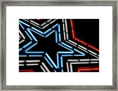 Neon Star Framed Print by Darren Fisher