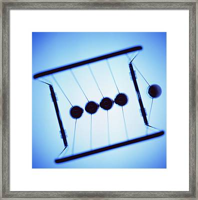Newton's Cradle Framed Print by Kevin Curtis