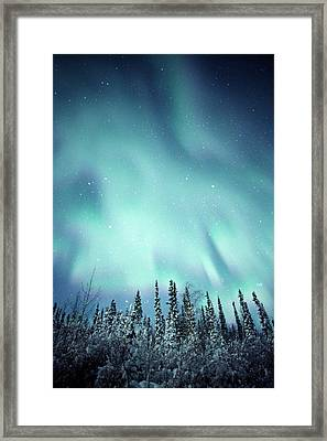 Northern Lights Over Snow Covered Framed Print by Robert Postma