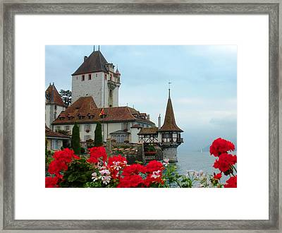 Oberhofen Castle With Flowers Framed Print by Marilyn Dunlap