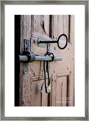 Old Door Of Wood With Its Worn Lock Framed Print by Bernard Jaubert