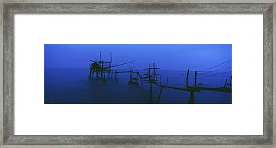 Old Fishing Platform Over Water At Dusk Framed Print by Axiom Photographic